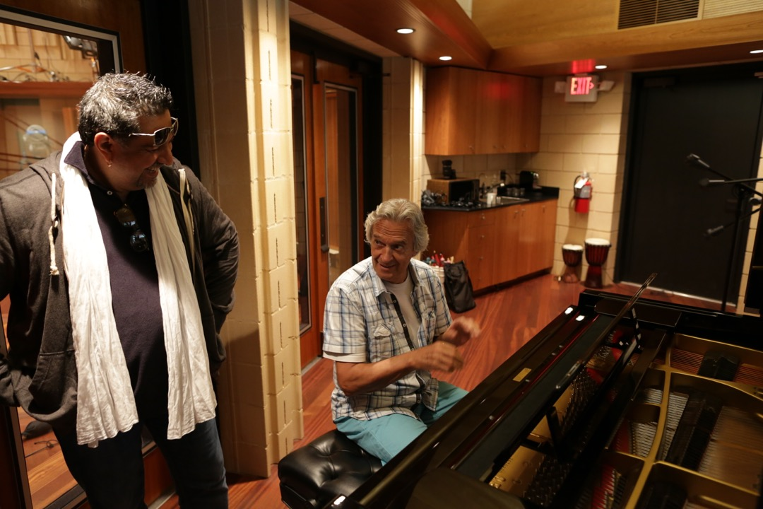 John McLaughlin plays piano in Booth A